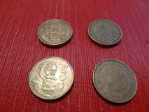 four 100 Peso Mexican coins in Kingwood, Texas